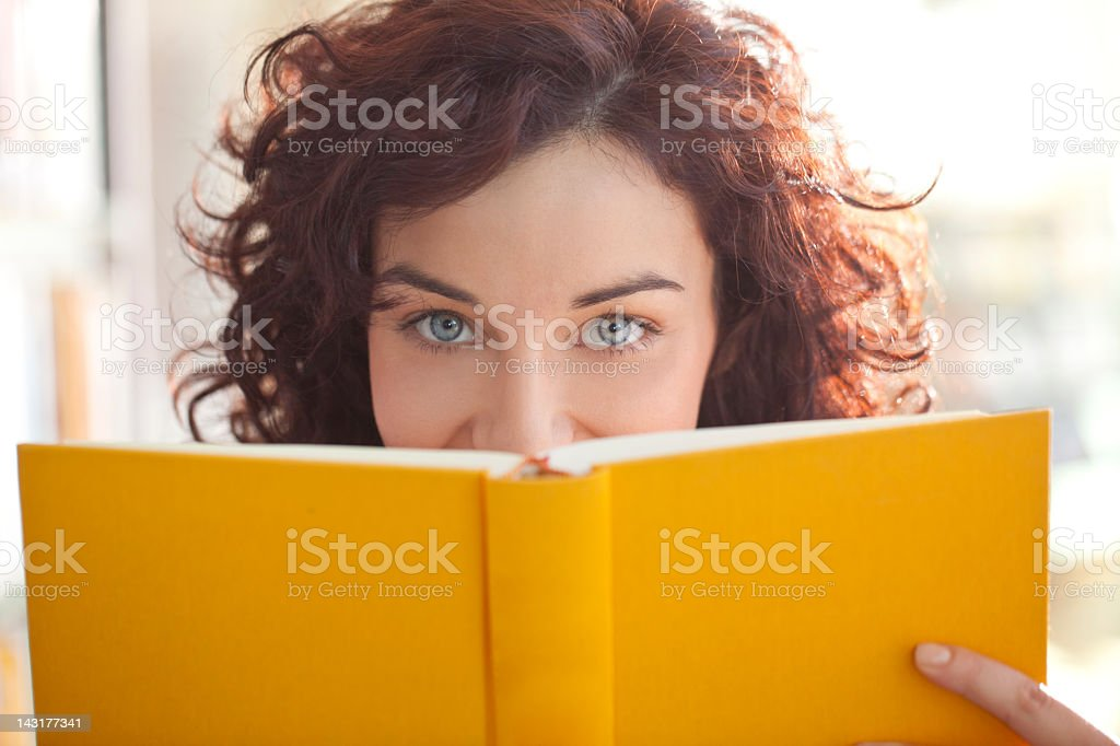 Student reading at the library stock photo