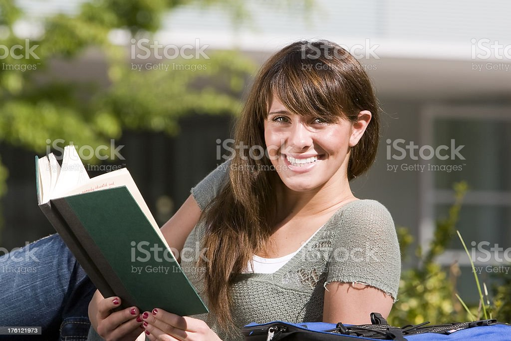Student reading book outdoors royalty-free stock photo