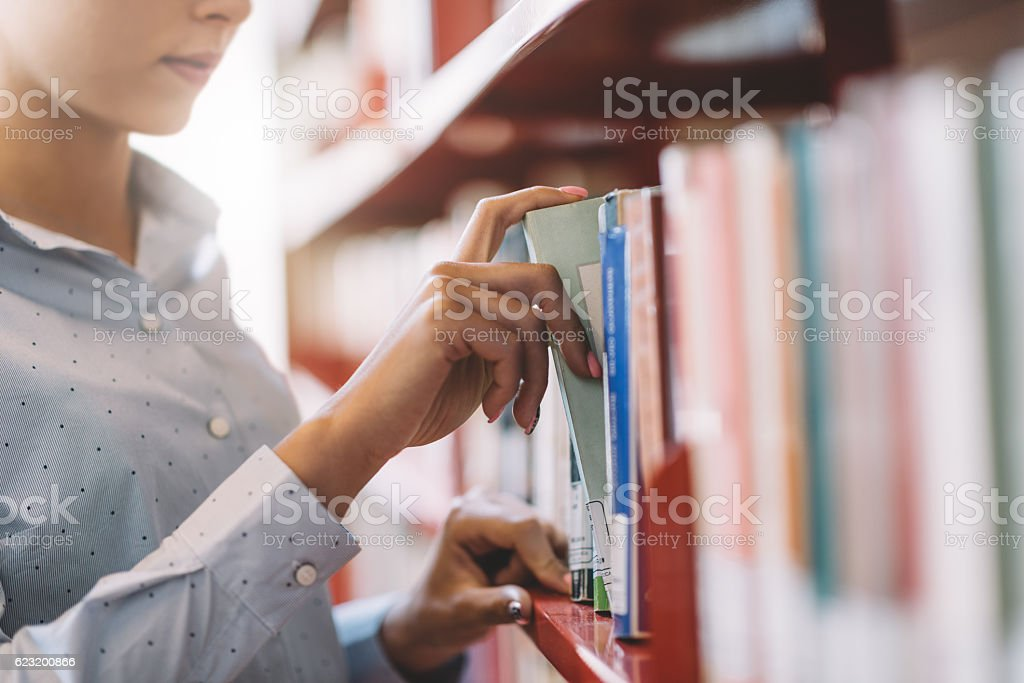 Student searching books bildbanksfoto