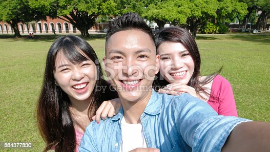 644191686 istock photo student selfie happily 884377830