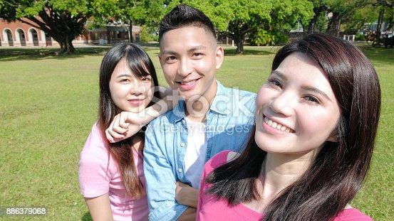 644191686 istock photo student selfie happily 886379068