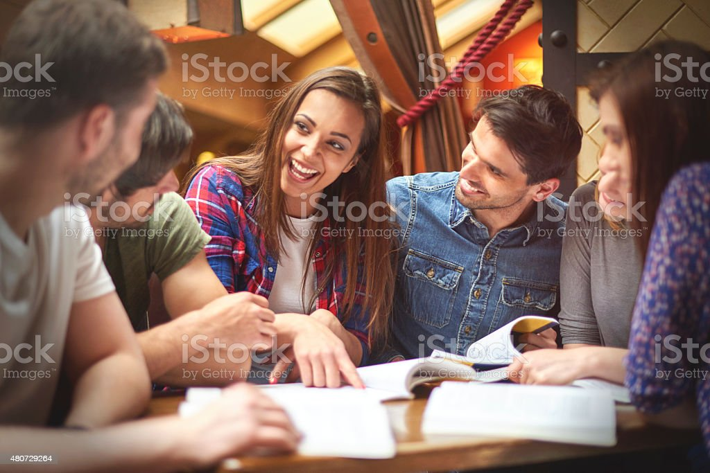 Student sharing her knowledge with her colleagues stock photo