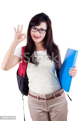 istock Student showing approval hand gesture 502821155
