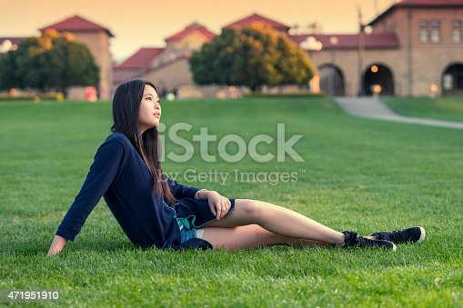 istock Student  sitting on the  campus green grass 471951910
