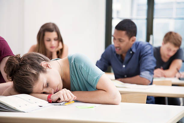 Student sleeping in class stock photo
