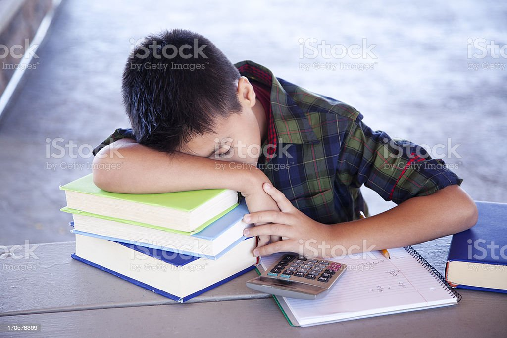 Student sleeping on books royalty-free stock photo