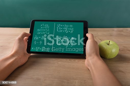 istock Student Solving Math Problem On Digital Tablet 906744668