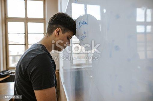 899619542 istock photo Student solving math problem 1152434691
