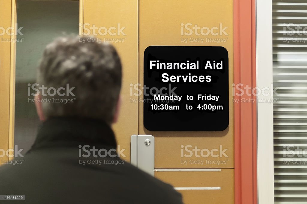 Student Standing in front of Financial Aid Services Office stock photo