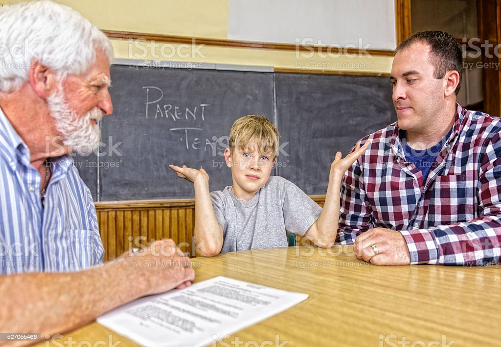 A child explains that he did not do it at a teacher parent conference...