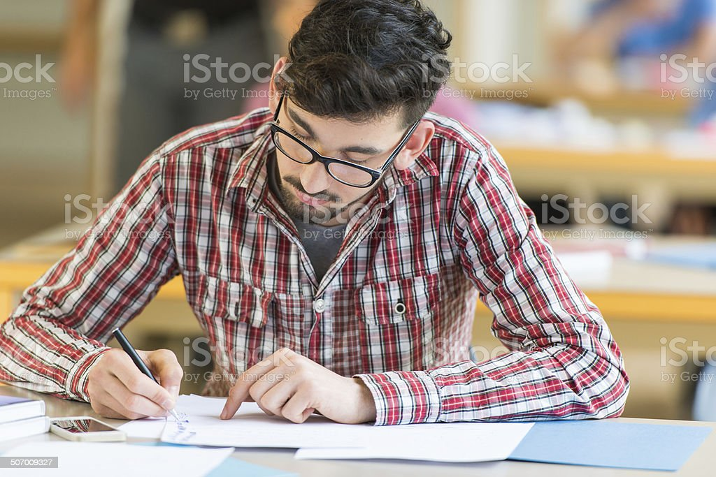 Student Study In Classroom stock photo