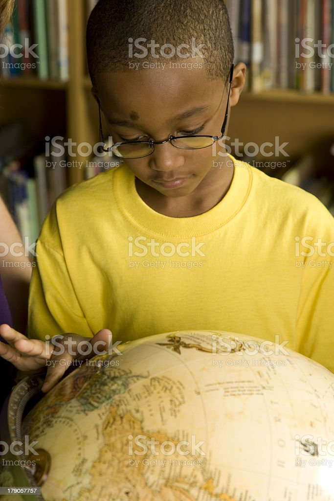 Student Studying a Globe royalty-free stock photo