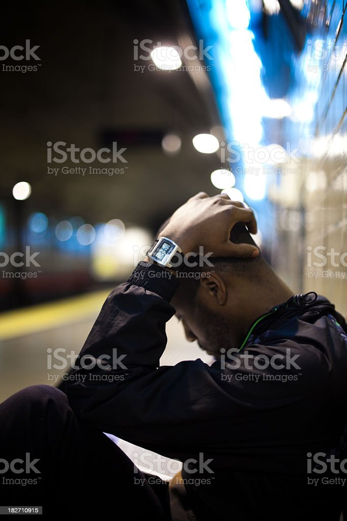 Student Studying and Waiting for a Subway stock photo