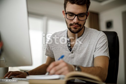 624546230 istock photo Student studying at home 1135300897