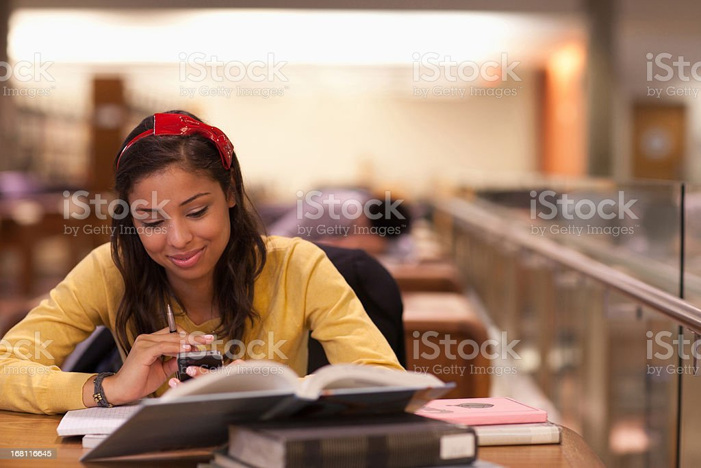 Student studying in library royalty-free stock photo