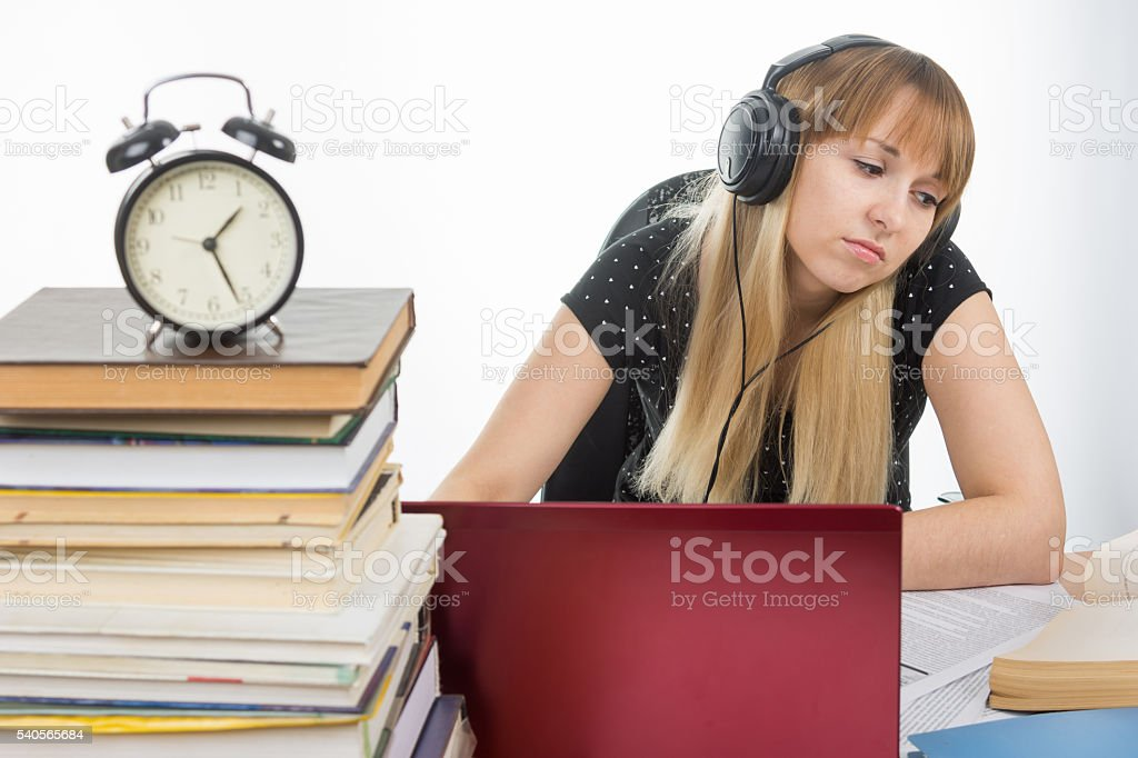 Student studying late at night preparing for the exam stock photo