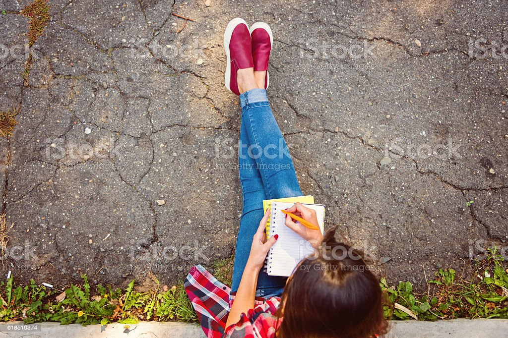 student studying outdoors stock photo
