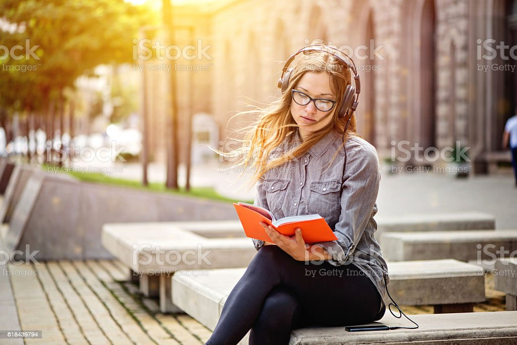 student studying outside stock photo