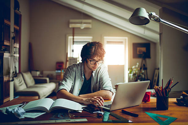 Student studying Photo of student studying using mouth stock pictures, royalty-free photos & images