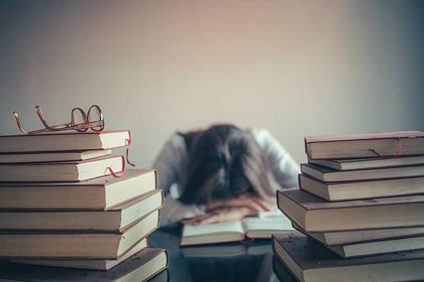 Student Studying Sleeping on Books stock photo