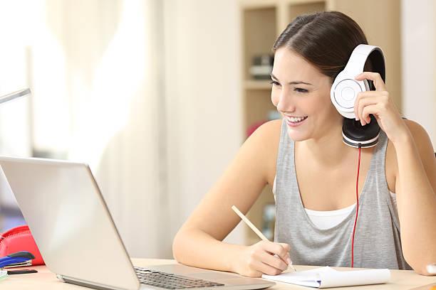 student studying watching video lecture - nachrichten video stock-fotos und bilder