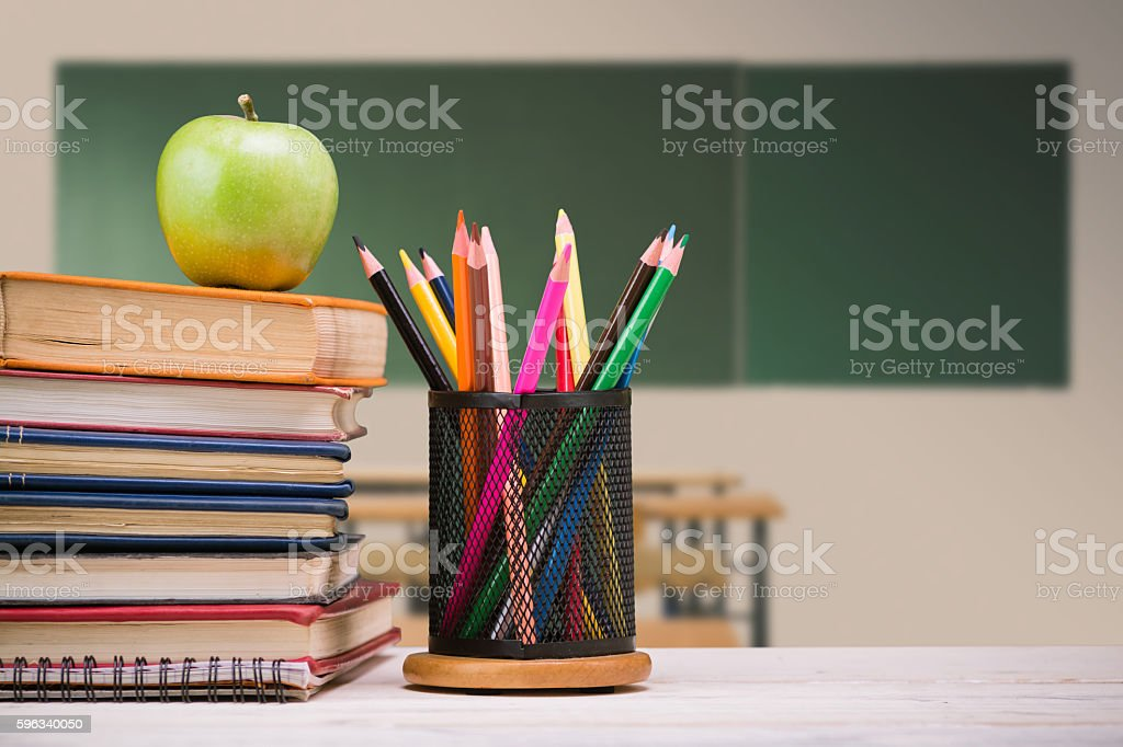 Student table in front of chalkboard royalty-free stock photo