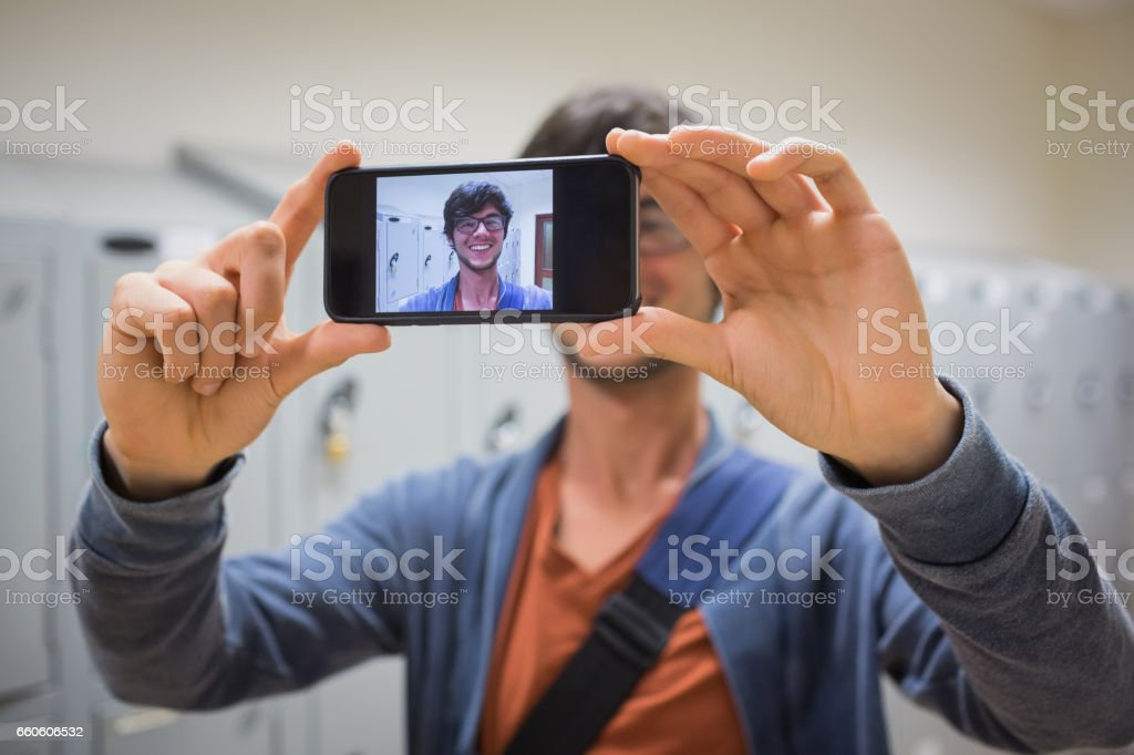 Student taking his selfie on smartphone royalty-free stock photo