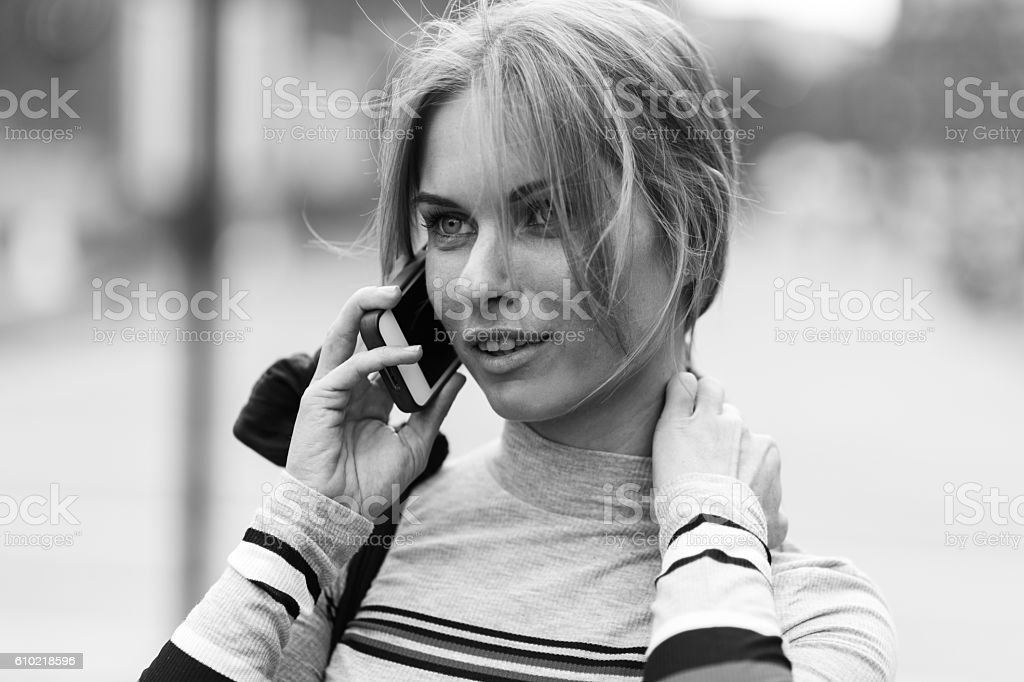 Student talking on phone ,black and white photo stock photo