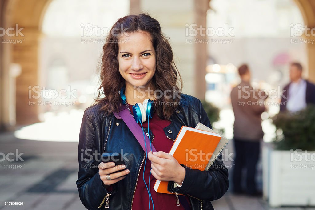 Student texting on a cell phone stock photo