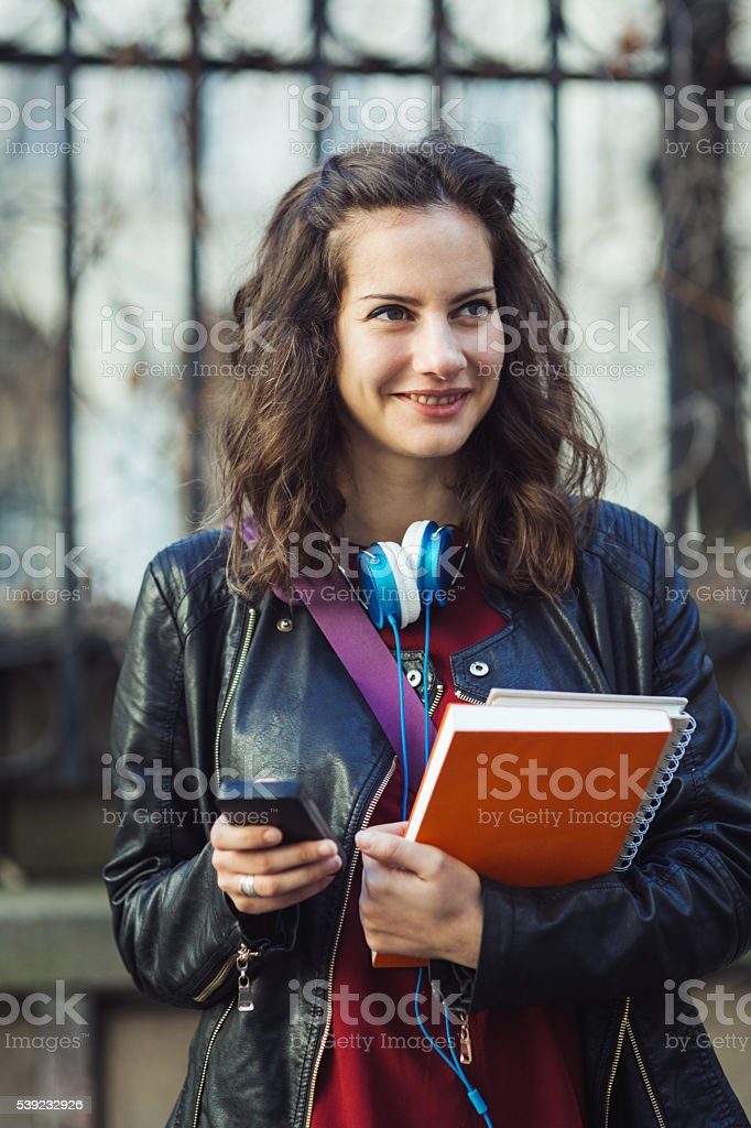 Student texting on a cell phone royalty-free stock photo
