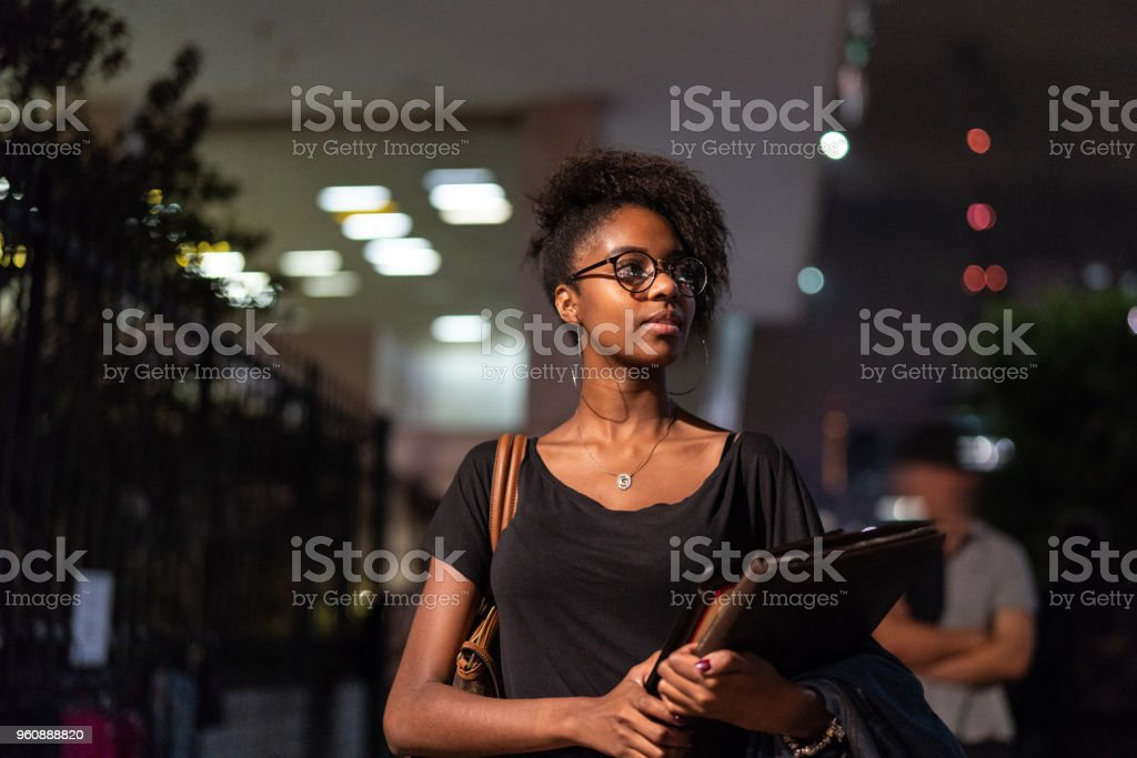 Student University Walking in the Street at Night stock photo