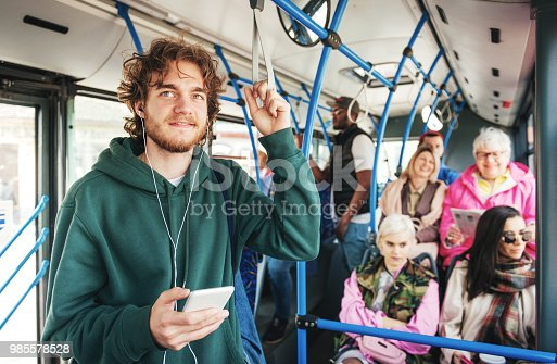 People using public transportation every day. Multi ethnic group of people of all ages use public bus for commuting.
