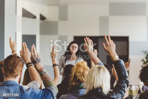 istock Student voting on seminar, raising hands 481711194