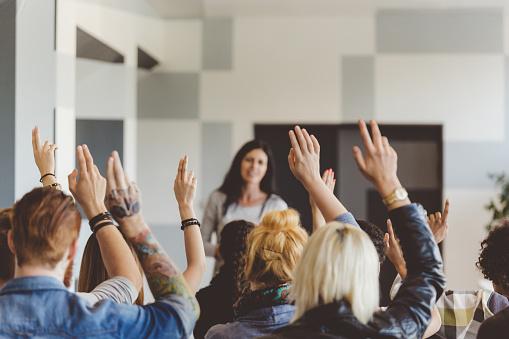istock Student voting on seminar, raising hands 481711194