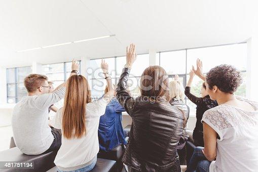 istock Student voting on seminar, raising hands 481751194