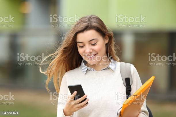 Student walking and reading phone messages picture id647276674?b=1&k=6&m=647276674&s=612x612&h=8w109ncqmvg079gnien5jc3lwrc3pt cpxy5vlf7ghw=