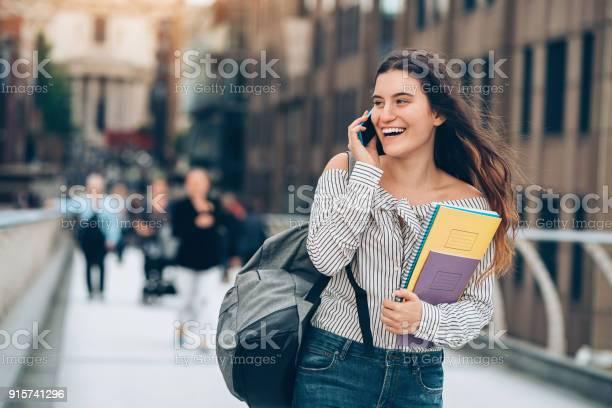 Student walking and talking on the phone picture id915741296?b=1&k=6&m=915741296&s=612x612&h=oclcudwe9sbljqf8knoth46cs544sxd0wmfiitsivnu=