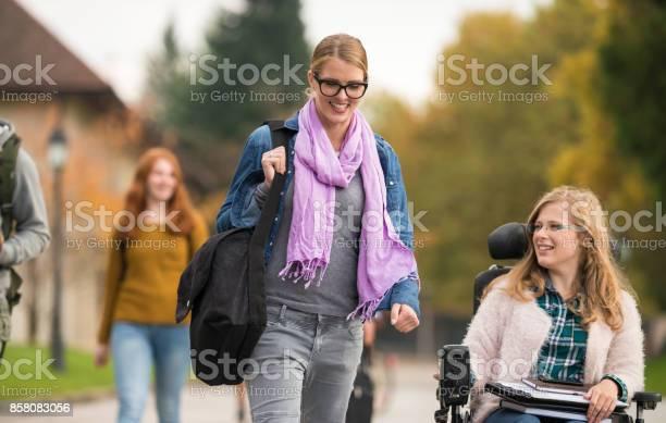 Student walking beside a friend with disability picture id858083056?b=1&k=6&m=858083056&s=612x612&h=vt4sbefg8dmtnwbk5ysjg1jhdcsexuw3er8h ea0zu0=