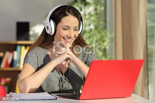 istock Student watching video tutorials on line 807742742