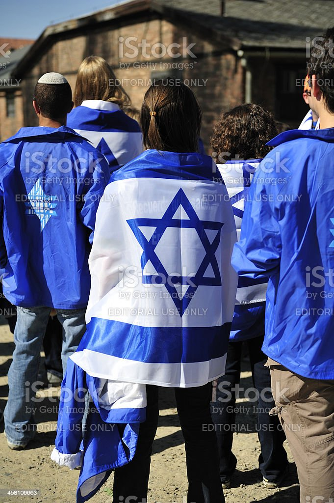 Student wearing an Israeli flag at the Auschwitz concentration camp stock photo