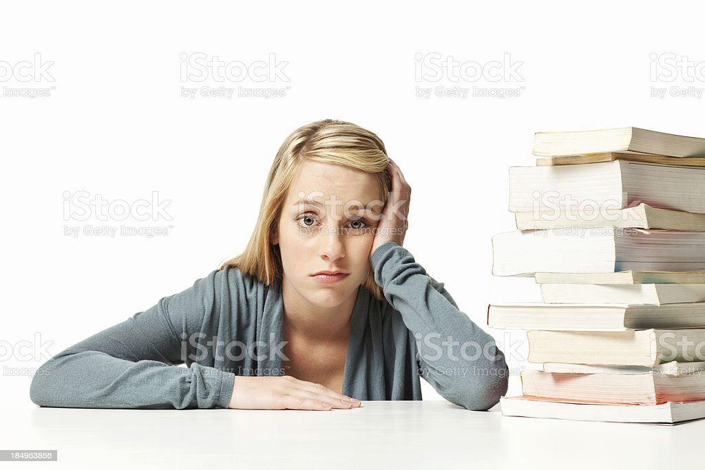 Student With a Large Stack of Books stock photo
