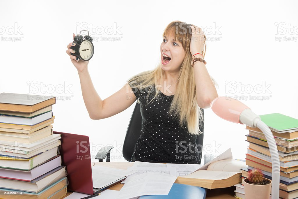 student with an alarm clock in hands understand that slept stock photo