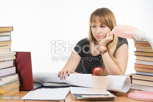 508126619istockphoto Student with contempt and weariness looking at laptop monitor 539811322