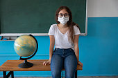 istock Student with face mask wait in classroom. Education process in pandemic. 1271882582