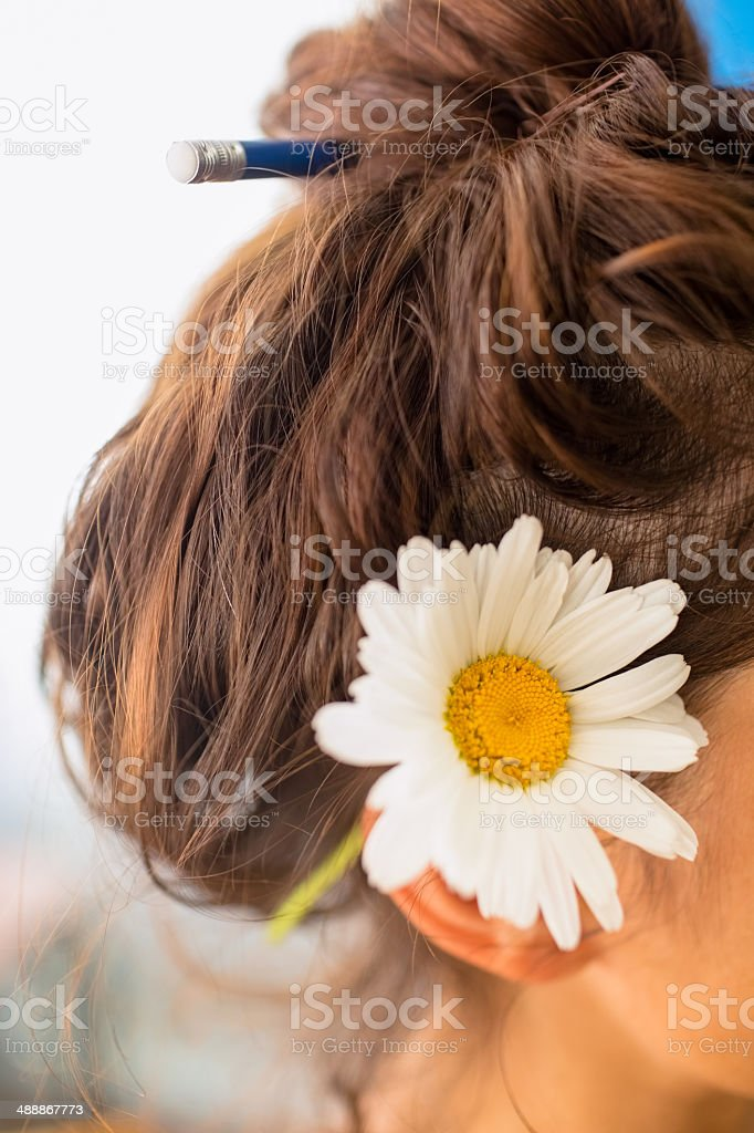 Student with flower behind her ear stock photo
