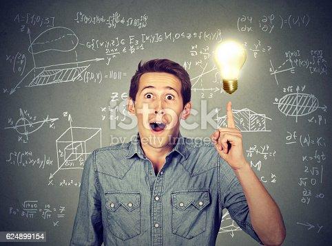 istock student with idea light bulb high school maths formulas 624899154