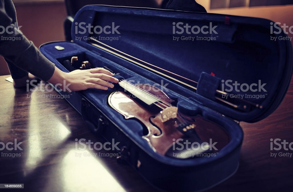 Student with open violin case stock photo