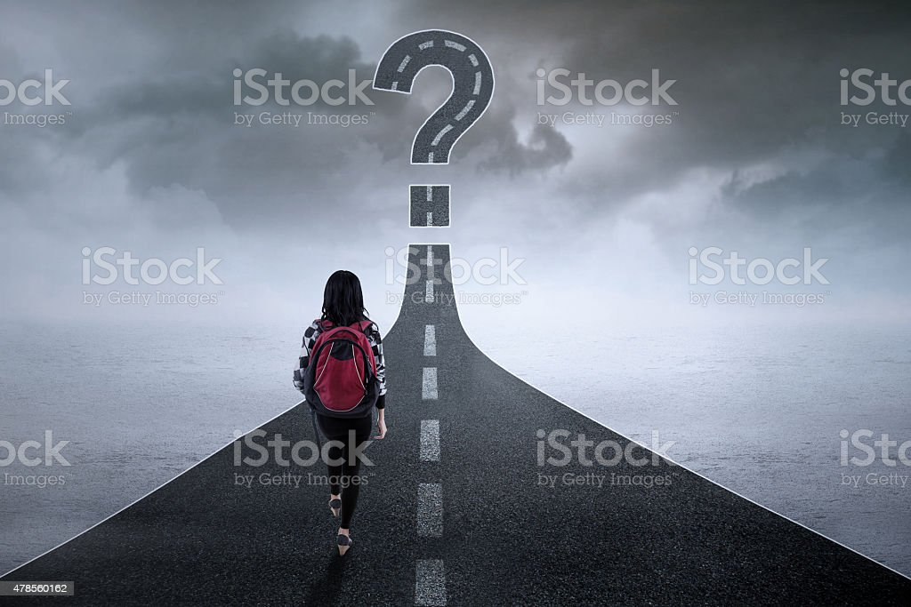 Student with question sign on the road stock photo