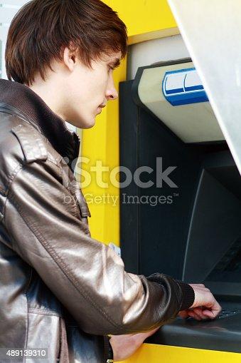 945598452 istock photo student withdrawing money 489139310