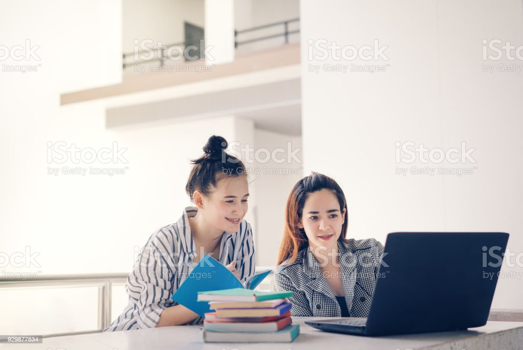 Student women teamwork together working study online or homework with laptop computer and meeting in university campus indoor stock photo